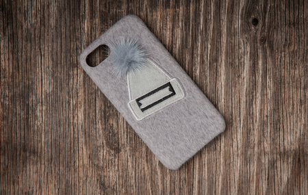 Cell phone case over rustic wood, winter theme