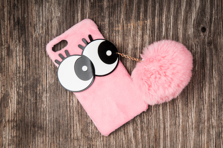 Pink mobile phone case with pom pom pendant