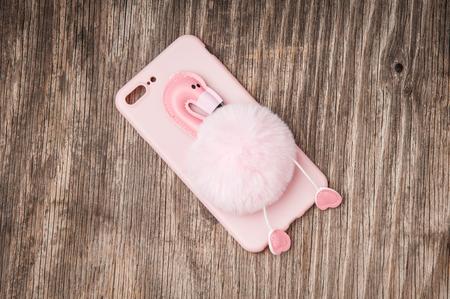 Pink flamingo on mobile phone case 版權商用圖片