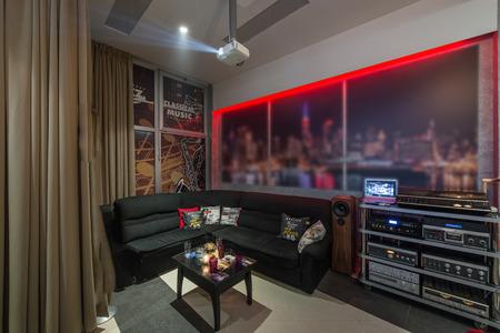 Sound system and corner sofa in living room intrerior
