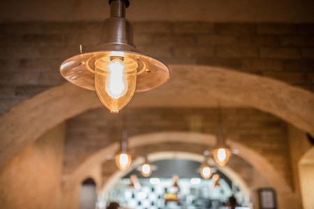 Old vintage chandelier in restaurant interior