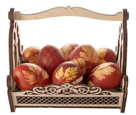 Easter eggs in a decorative basket on a white background Stock Photo - 17499791