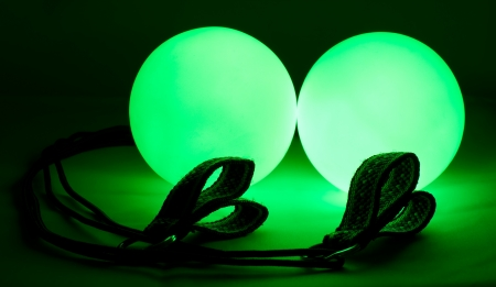 poi: equipment for juggling - green luminous poi balls Stock Photo