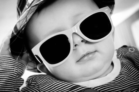 Cool baby in sunglasses and a hat photo