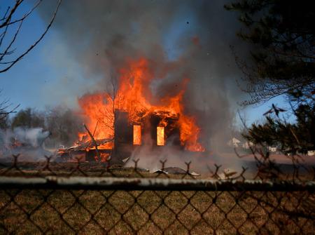 smoldering: black smoke rising Stock Photo