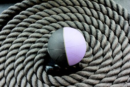 coiled workout ropes with a medicine ball