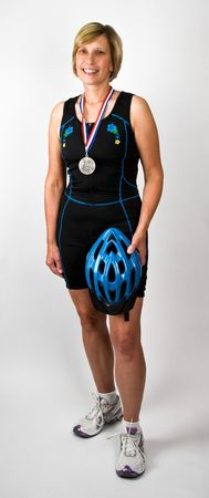 physically: Physically Fit Senior  Boomer Women In Triathlon Workout Clothes and Bike Helmet Stock Photo
