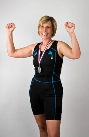 physically: Physically Fit Senior  Boomer Women in Triathlon Gear and Winners Medal  Stock Photo