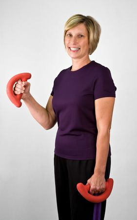 physically: Physically Fit Senior  Boomer Women Working Out With Weights