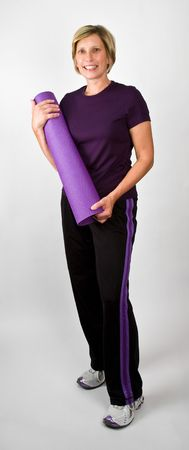physically: Physically Fit Senior  Boomer Women With Yoga  Polaties Mat    Stock Photo