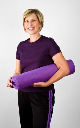 boomer: Physically Fit Senior  Boomer Women With Yoga  Polaties Mat    Stock Photo