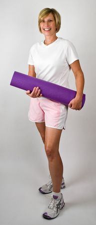 physically: Physically Fit Senior  Boomer Women With Yoga  Polaties Mat