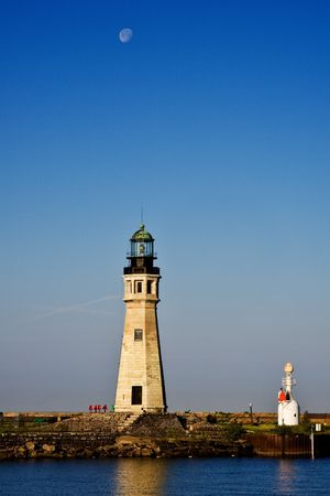 erie: Great Lakes Buffalo Main Lighthouse on Lake Erie with setting moon