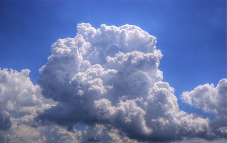 A beautiful white summer cloud in a blue sky