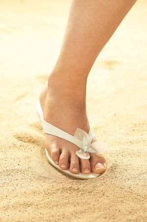 Woman foot on sand photo