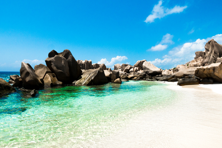 Natural pool of turquoise water on a tropical desert beach, Anse Marron, La Digue, Seychelles