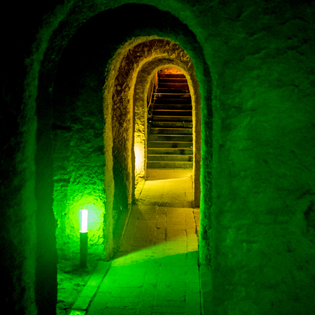 Dungeons with archway and arched entrance with green light Stock Photo