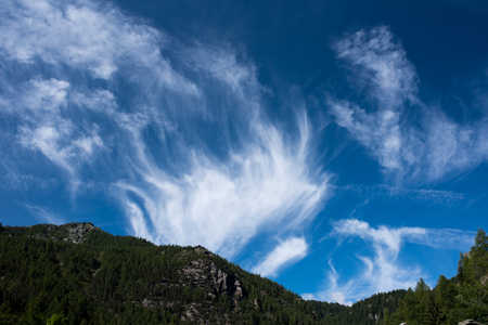 Cirrus Intortus, type of clouds in a mountains landscape Stock Photo