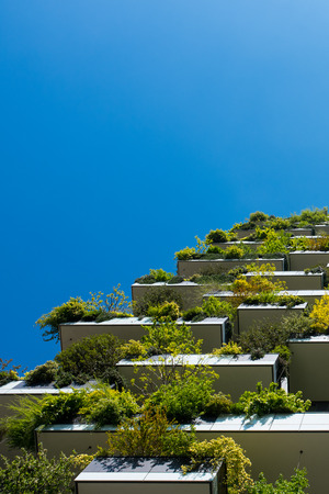 Modern and ecologic skyscrapers with many trees on every balcony. Bosco Verticale, Milan, Italy Stock Photo