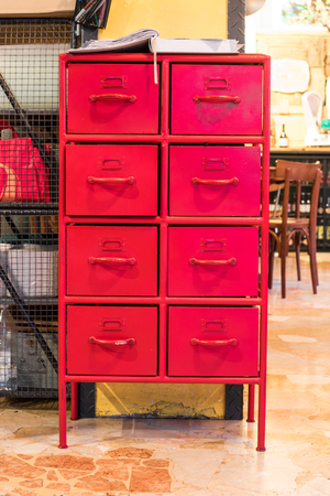 Old metal document cabinet painted red, interior design details