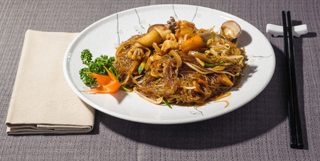 seafood soya spaghetti with clams, shrimps, squid, crab pulp, carrots and courgettes, seasoned with tamarisk sauce