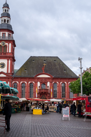 MANNHEIM, GERMANY, 05/11/2019: market square with stands in front of the town hall on a rainy day