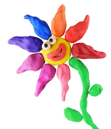 plasticine smiling flower on the white background