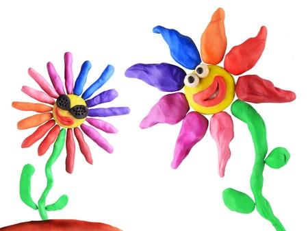 plasticine flowers friendship on the white background photo