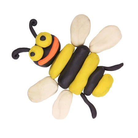 clay craft: isolated child hand made bee on the white Stock Photo