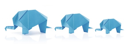 elephant family in origami tehnique on the white background Stock Photo