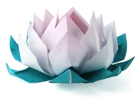 Origami lotus on a white background photo