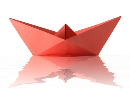 Paper origami red boat on the white background Stock Photo - 14528080
