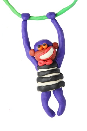 Plasticine smiling monkey on a white background