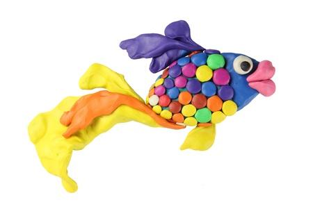 children s art: plasticine art fish on the white background