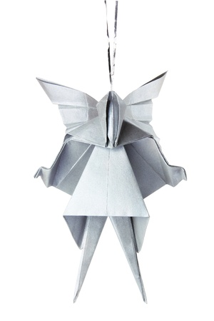 Christmas silver origami angel on the white background