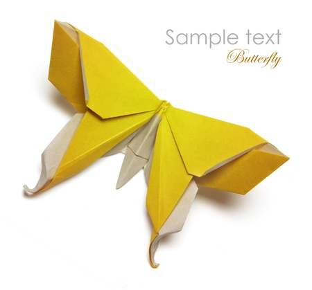 Yellow origami butterfly on the white background