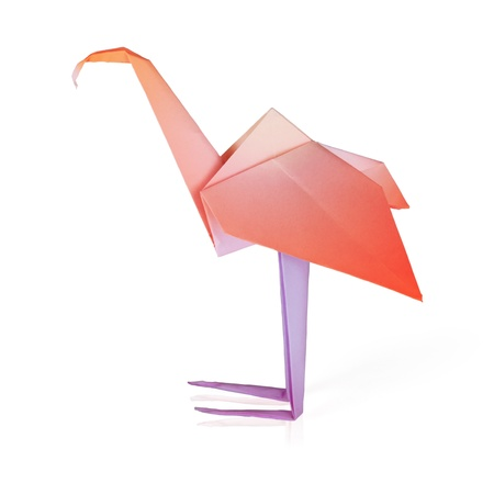 Origami pink paper flamingo on a white background photo