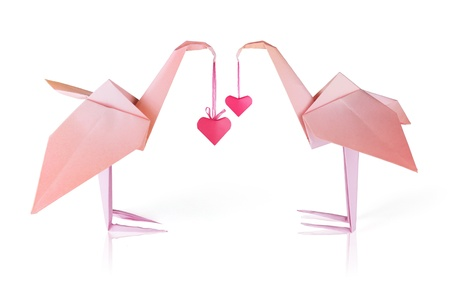 Origami pink paper loving flamingo couple whith red hearts  Stock Photo