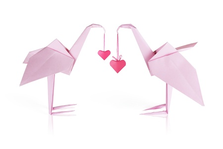 Origami pink paper loving flamingo couple whith hears photo