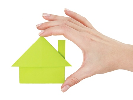 Paper green house in the hand Stock Photo - 17728438