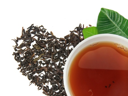A cup of tea with tea brew heart on a white background Stock Photo - 17855741