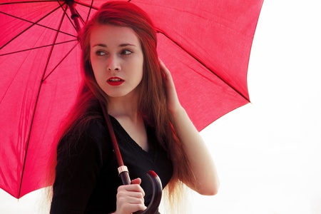 Girl with umbrella and red lips Stock Photo - 19856555