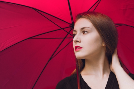 Fastion girl with red lips and umbrella background Stock Photo - 19856561