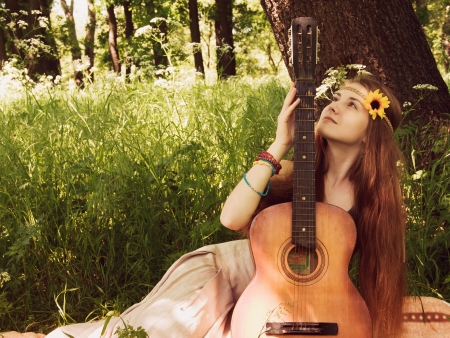 Hippie ethnic smiling girl singer with guitar in the forest Stock Photo - 19856566
