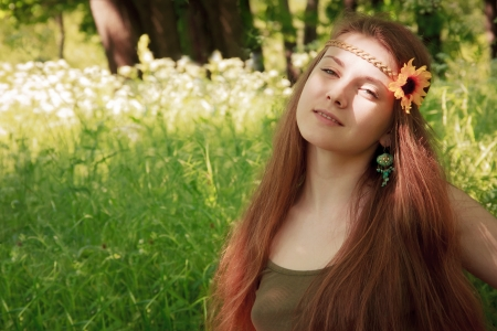 Smiling young beautiful girl in the forest photo