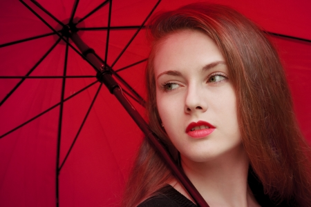 Fastion girl with red lips and umbrella background Stock Photo - 19856556