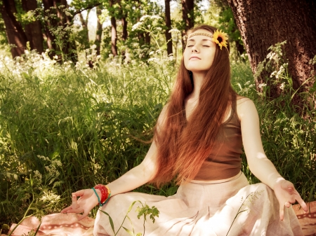 hippy: Hippie yoga girl in meditation in the forest Stock Photo