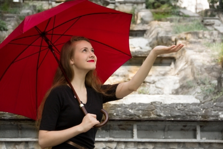 Girl with red lips and on a umbrella background Stock Photo - 19856557