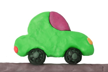 Green child plasticine ecology car on a white background Stock Photo - 20270389
