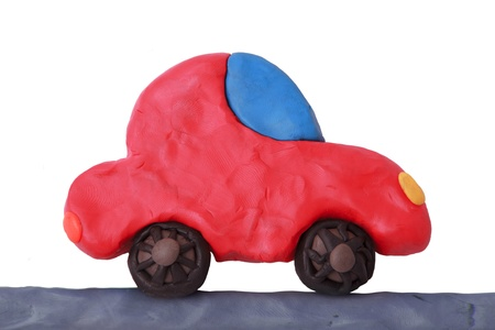 Red child plasticine ecology car on a white background Stock Photo - 20269767